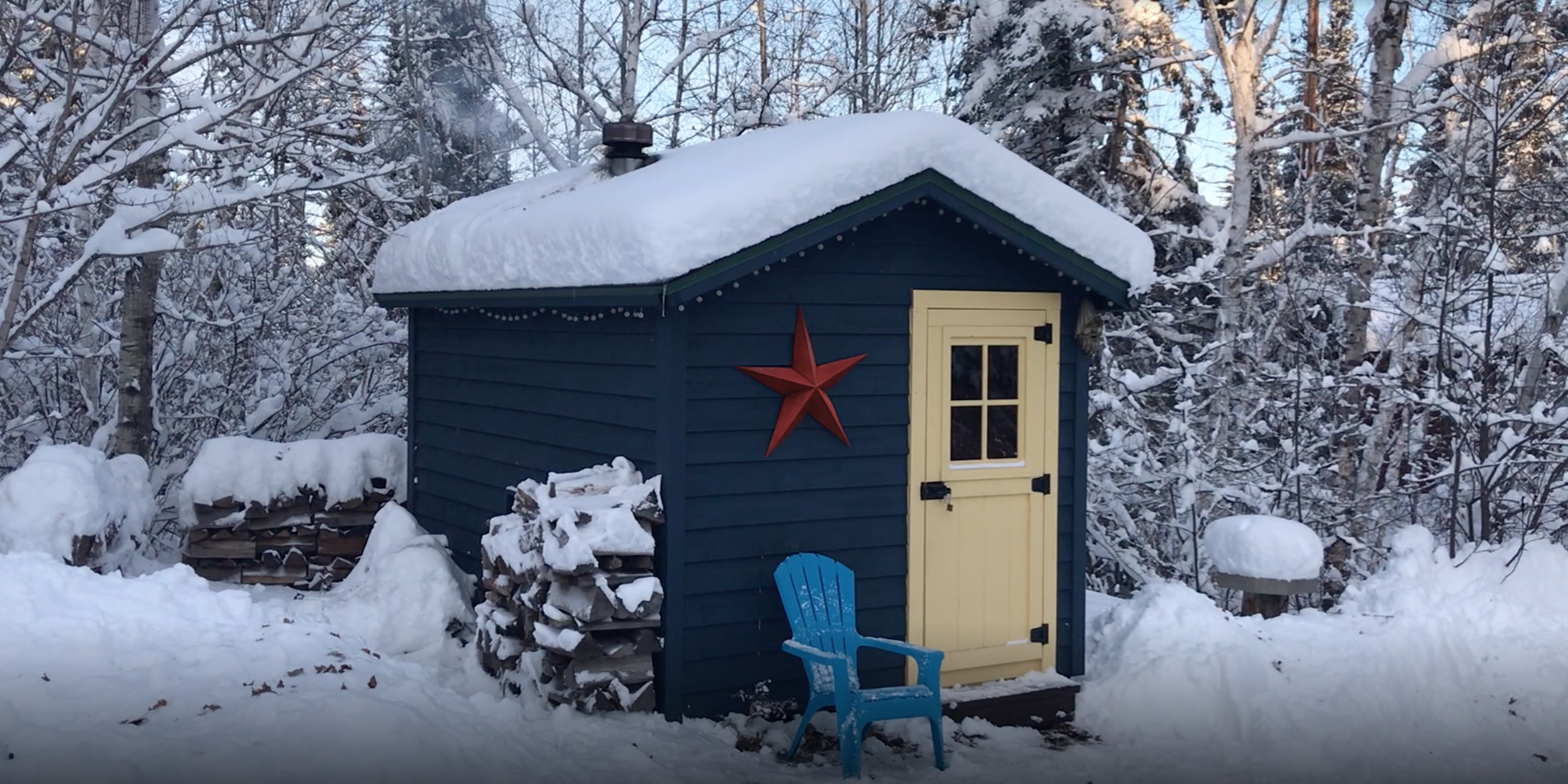 A warming house out in the snowy woods